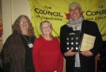Grant Shilling  from Dawn to Dawn accepting Community Action Award from CVCofC Chair Linda Safford and Vice-Chair Alice Dewolf